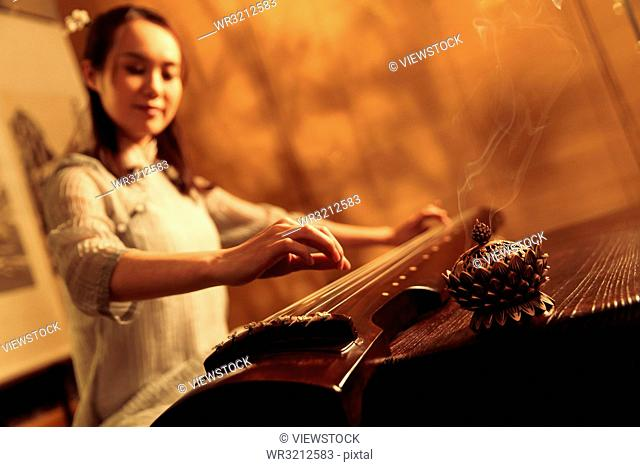 Young woman playing the lyre