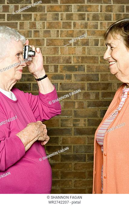 Senior woman taking a photograph