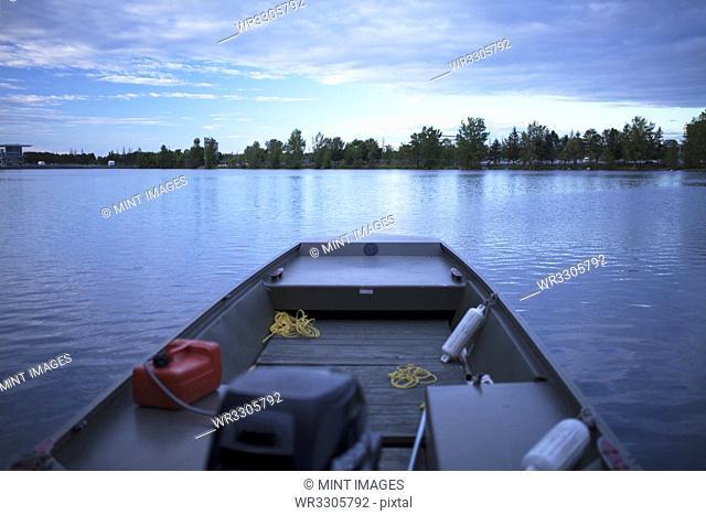 Fishing boat on still rural lake