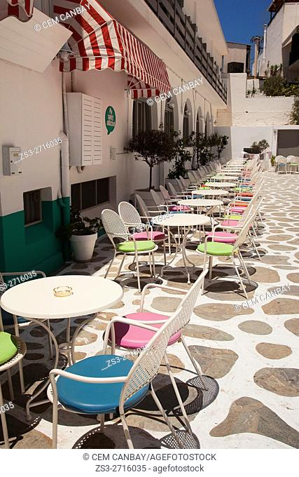 Open-air cafe-restaurant with colorful chairs in the old town Chora, Naxos, Cyclades Islands, Greek Islands, Greece, Europe