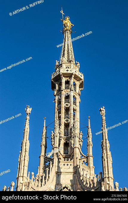 Madonnina (small Madonna). Gold gilded statue on the highest spire of the Milan Cathedral (Duomo di Milano). Piazza del Duomo, Milan, Lombardy, Italy, Europe