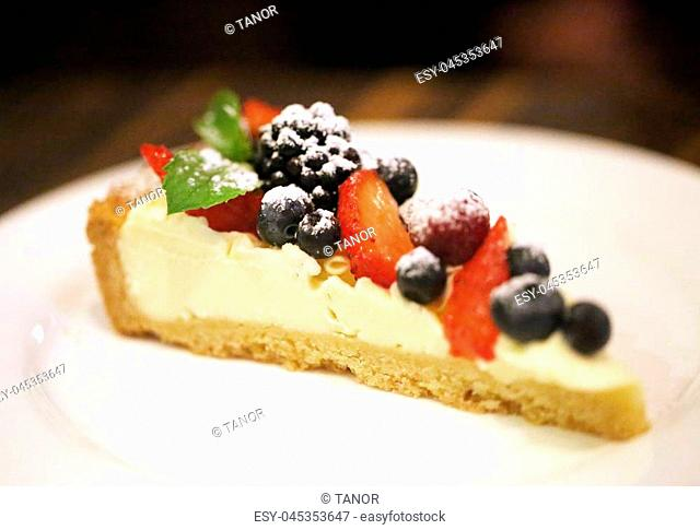 Photo of a bright delicious cake with berries for dinner