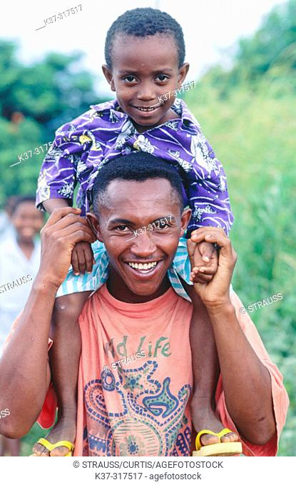 Smiling father with son. Madagascar