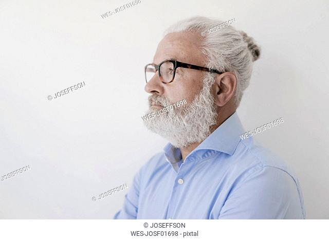 Portrait of serious mature man with beard and glasses