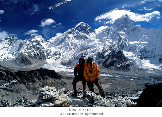 Hight spot, viewpoint. Over panorama of Everest range of peaks. Glacier path, snowfields. Two men. Scenics & landscapesGeography - physicalSports