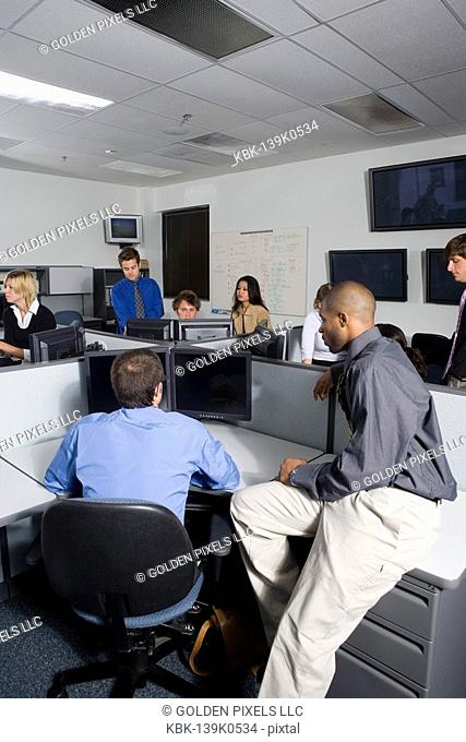 Group of young workers in office