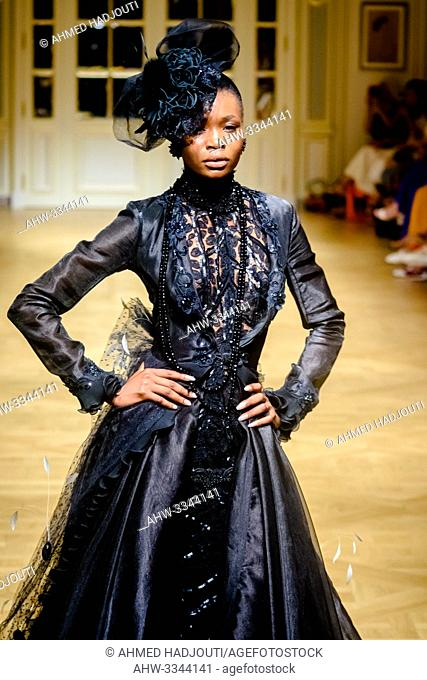 PARIS, FRANCE - June 30 : A model walks the runway during the Slava Zaitsev Show As part of the Oriental Fashion Show during the Paris Fashion Week Haute...