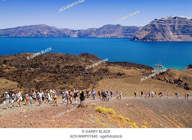 Tourists on Nea Kameni, the Active Island Volcano in the Caldera, Santorini, Cyclades Islands, Greece