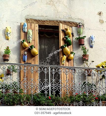 Wrought iron balcony and local pottery. Sault. Vaucluse, Provence. France