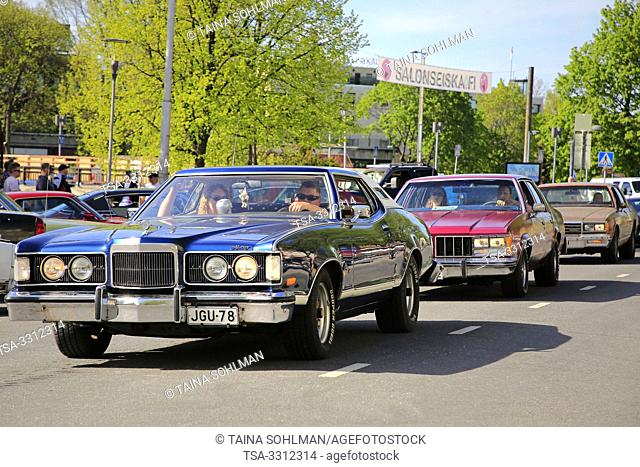 Salo, Finland. May 18, 2019. Classic cars driving along street to participate in the gathering of Salon Maisema Cruising 2019