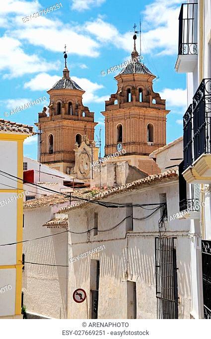 Townhouses with church (Santa Maria de la Encarnacion) to the rear, Velez Rubio, Almeria Province, Andalusia, Spain, Western Europe
