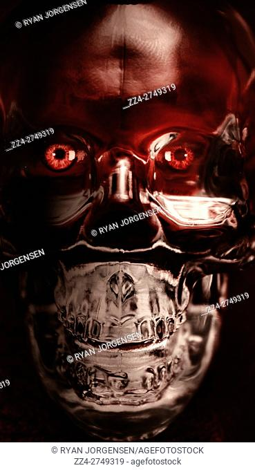 Creative futuristic portrait on the glaring face of a red eyed crystal robotic skeleton. Cyborg evolution to the singularity