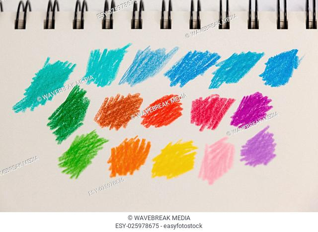 Hand drawn colorful stripes on note book