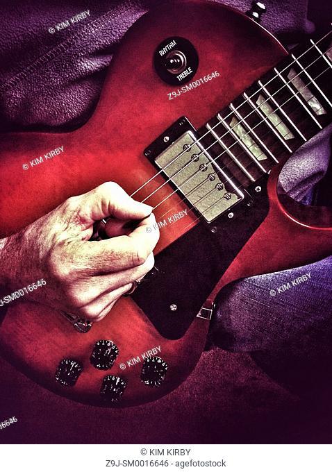 Close up of man playing electric guitar
