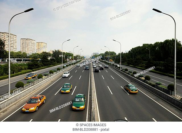Taxis and other cars drive the second ring road around Beijing