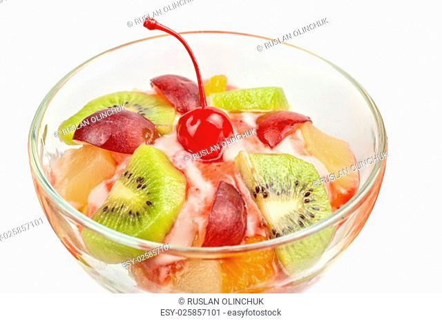 Fruit salad with ice cream in plate