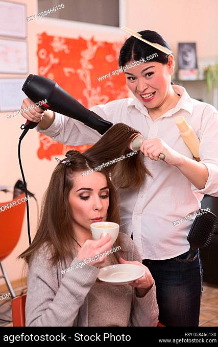 Picture of beautiful lady sitting in chair, drinking coffee and having her hair washed in hairdressing saloon. Fashion and beauty concepts