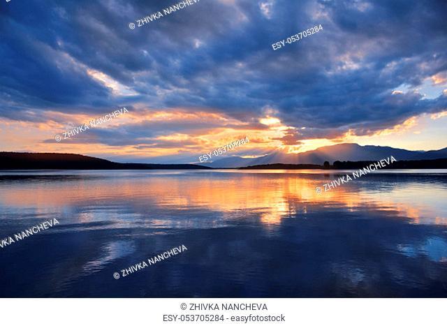 Incredibly beautiful sunset.Sun, sky, lake.Sunset or sunrise landscape, panorama of beautiful nature. Sky with amazing colorful clouds