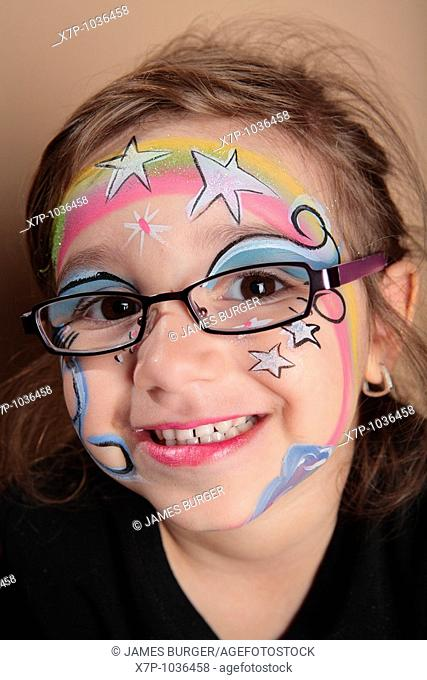Girl with glasses and face paint