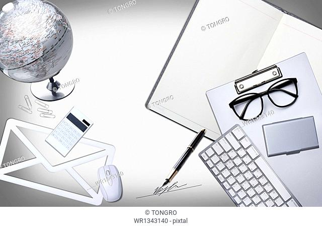 a desk full of work related items