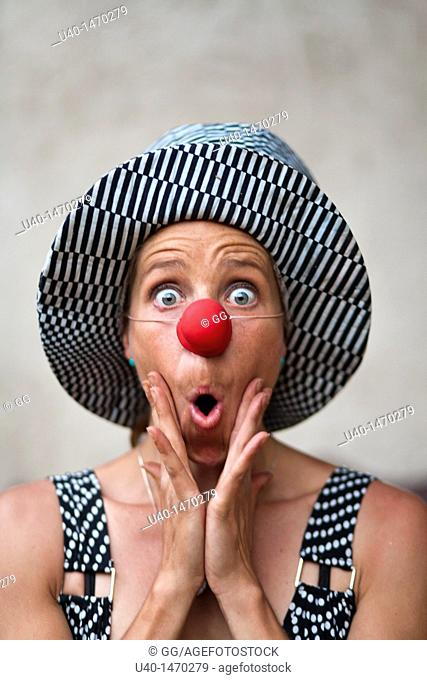 Woman with clown nose making faces