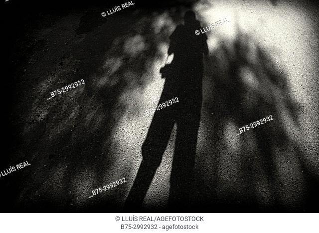 Shadow of photographer taking a photo. Santo-Pietro-di-Tenda, Corsica, France