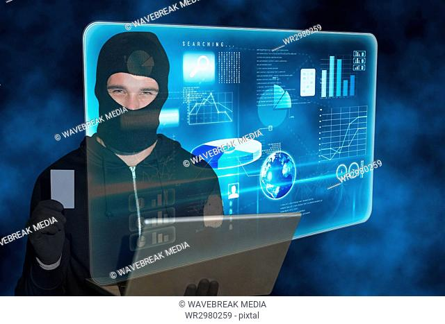 Hacker standing in front of 3D blue interface