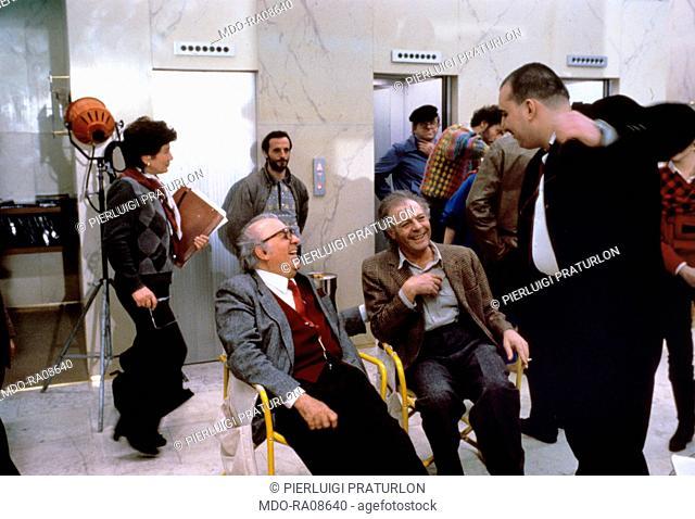 Italian actor Marcello Mastroianni and Italian director Federico Fellini smiling on the set of the film Ginger & Fred. 1985