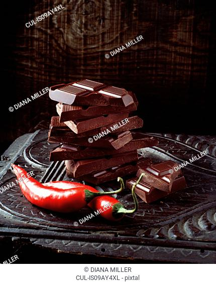 Food, chilli chocolate, raw red chilli peppers, vintage wooden surface