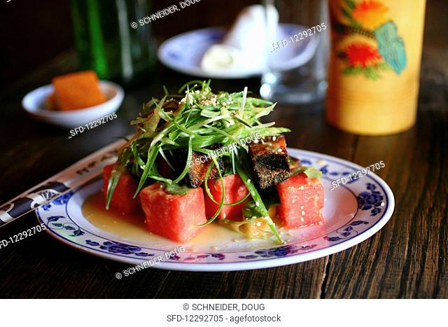 Watermelon pickle and crispy pork salad (pork belly, fresh herbs, sweet ginger)