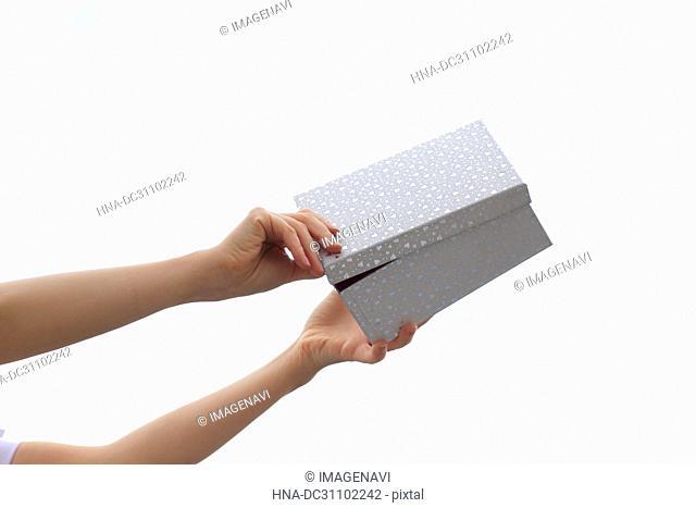 Woman Hand Holding Gift Box