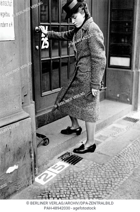 The picture from a Nazi news report shows a woman walking into a building next to the newly introduced address number stones in Berlin, Germany, November 1940