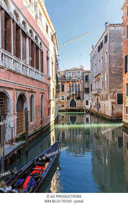 Gondola sailing in Venice canal, Veneto, Italy