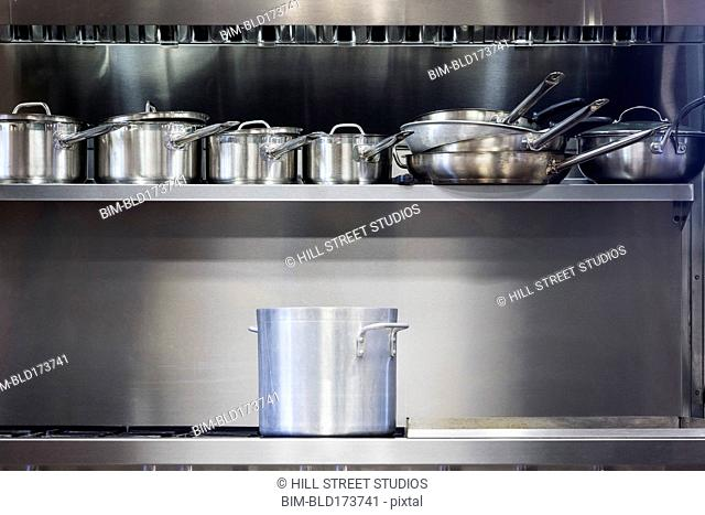 Pot on stove in commercial kitchen
