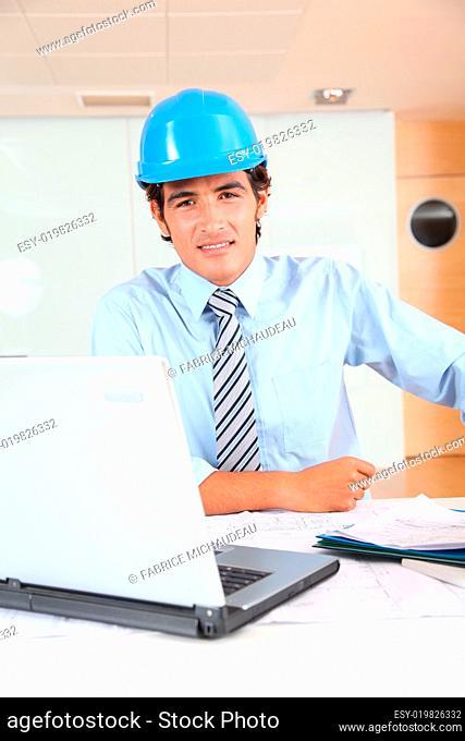Portrait of architect wearing security helmet