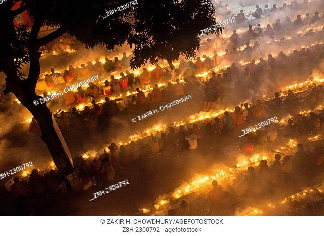 """People of Hindu Community (Bangladeshi) celebrating """"Rakher Upobas†a culture in every Bengali month Kartik. It's a fast day for keeping safe all of own family..."""