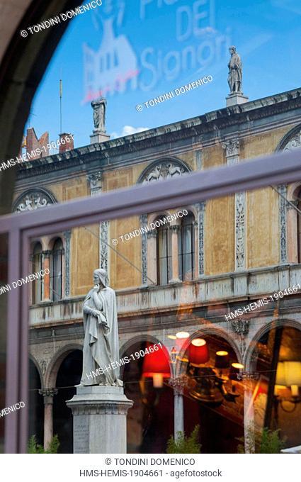 Italy, Veneto, Verona, listed as World Heritage by UNESCO, Piazza dei Signori (or Piazza Dante), statue of Dante Alighieri reflection in a window
