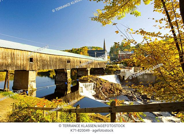 The covered bridge with waterfalls and fall foliage color in Bath, New Hampshire, USA