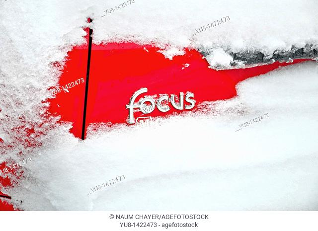 Detail of covered by snow Ford focus American car