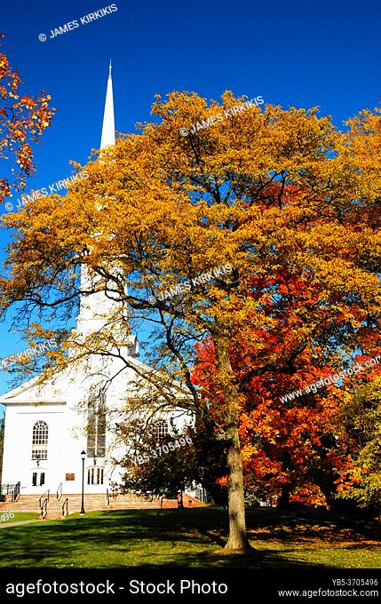 Fall colors surround a classic white clapboard church in Westfield, New Jersey
