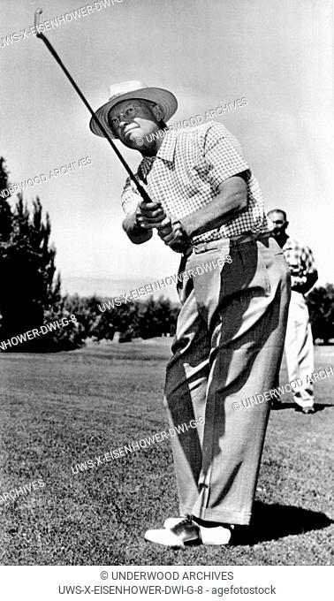 Englewood, Colorado: August 13, 1953. President Eisenhower takes a practice swing with an eight iron as he warms up for a round of golf at Cherry Hills Country...