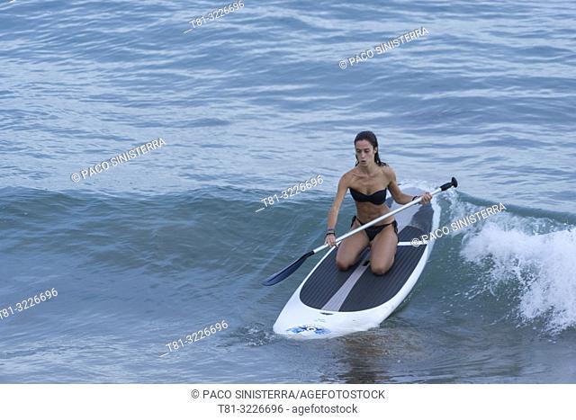 Girl doing paddleboard, Alcocebre, Castellon province, Valencian Community, Spain