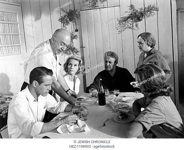 Director and cast of Exodus, 1960. Paul Newman, director Otto Preminger, Eva Marie Saint and Lee J Cobb confer over lunch during the making of Exodus