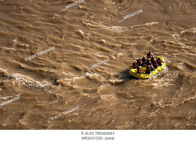 Tourists having fun rafting on the sacred River Ganges (Mother Ganga), Rishikesh, Uttarakhand (Uttaranchal), India, Asia