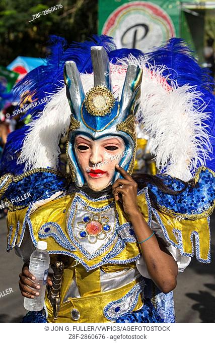 Marchers in elaborate costumes and masks march in the La Vega Carnival parade. The first documented Carnival celebration in what is now the Dominican Republic...