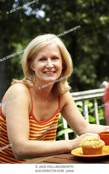 Portrait of a mature woman sitting at the table and smiling