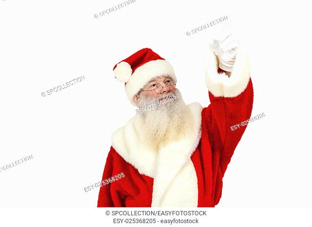 Santa Claus with real beard pointing upwards (isolated)