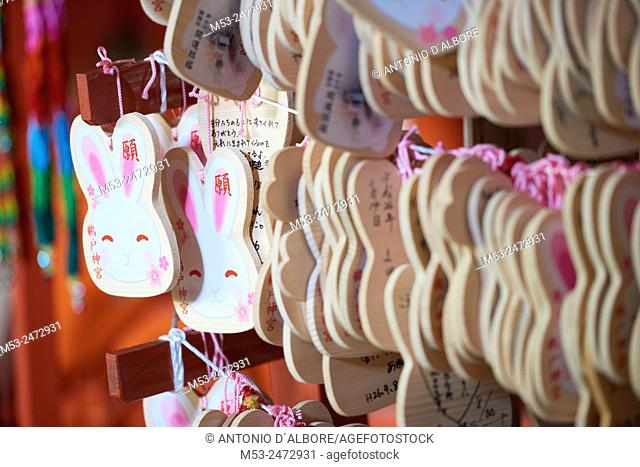 Ema wooden tablets shaped as a rabbit head at Udo-Jingu shinto temple. Ema tablets are sold in shrine and worshipper write prayers or wishes on them
