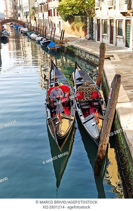 Gondolas moored in a canal in Venice, Italy