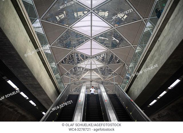 Singapore, Republic of Singapore, Asia - Escalators and interior view of the Expo station along the MRT network. The railway station was designed by the British...